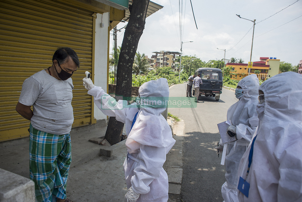 KMC (Kolkata Mucicipal corporation) health workers check for fever among residents of a middle class neighbourhood in Kolkata midst the 2nd phase of lockdown in India due to covid 19 pandemic. This is to curb the spread of Covid 19 in the country. The second phase is handled with more strict rules by the administration. Kolkata, West Bengal, India, April 25, 2020. Photo by Arindam Mukherjee/ABACAPRESS.COM