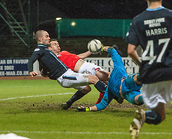 Dundee's James McPake and Ross County's keeper Antonio Reguero both injured in this collision. <br /> Dundee 1 v 1 Ross County, SPFL Premiership game player 4/1/2015 at Dundee's home ground Dens Park.