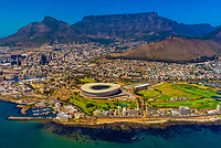 Aerial view of Cape Town (Cape Town Stadium in foreground, Signal Hill and Table Mountain in background), South Africa.