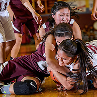 011714       Cable Hoover<br /> <br /> Rehoboth Lynx Amanda Martin (21) attempts to wrestle the ball away from Ramah Mustangs Taea Hill (24) and Wynter Henio (32) Friday at Rehoboth High School.