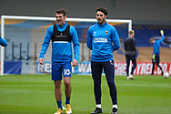AFC Wimbledon defender Will Nightingale (5) and AFC Wimbledon attacker Adam Roscrow (10) warming up prior to kick off during the The FA Cup match between AFC Wimbledon and Crawley Town at Plough Lane, London, United Kingdom on 29 November 2020.