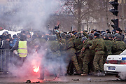 Moscow, Russia, 12/02/2005..Several thousand people demonstrate in central Moscow as part of a nationwide series of protests against recent social reforms which have replaced Soviet era benefits with cash payments. Soldiers and police beat back a group of young comunists and anarchists who attempted to break through a security cordon to halt passing traffic.