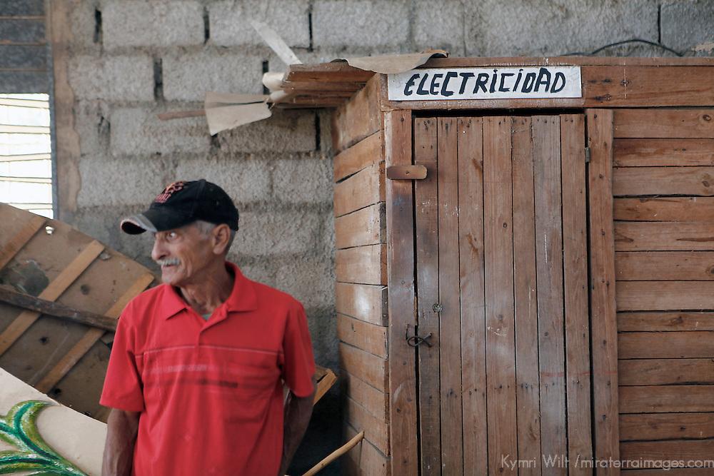 Central America, Cuba, Remedios. A Cuban electrician in the workshop of the Parrandas, Remedios.