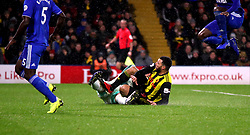 Watford's Troy Deeney challenges Cardiff City goalkeeper Neil Etheridge during the Premier League match at Vicarage Road, Watford.