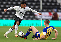 Derby County's Duane Holmes (left) and Southampton's James Ward-Prowse battle for the ball during the Emirates FA Cup, third round match at Pride Park, Derby.