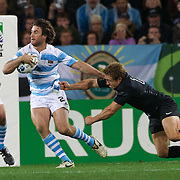 Argentina replacement Marcelo Bosch evades the tackle of England fly half Jonny Wilkinson during the England V Argentina, Pool B match during the Rugby World Cup in Dunedin, New Zealand,. 10th September 2011. Photo Tim Clayton