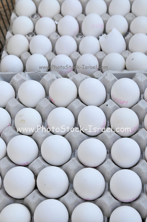 A pile of fresh eggs for sale at a market stall