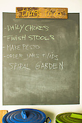 01 APRIL 2013 - BANGKOK, THAILAND: A list of chores on the chalkboard in the Hupe's home.    PHOTO BY JACK KURTZ