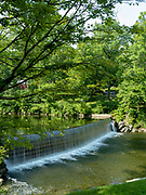 Image of the dam on the Green River, upstream from the Green River Covered Bridge, near Brattleboro, Vermont, USA.