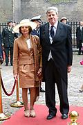 Prinsjesdag 2013 - Aankomst Parlementariërs bij de Ridderzaal op het Binnenhof.<br /> <br /> Op de foto:  Ivo Opstelten - Minister van Veiligheid en Justitie en partner