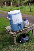 Water left out for travellers, with container for donations. Big Island, Hawaii