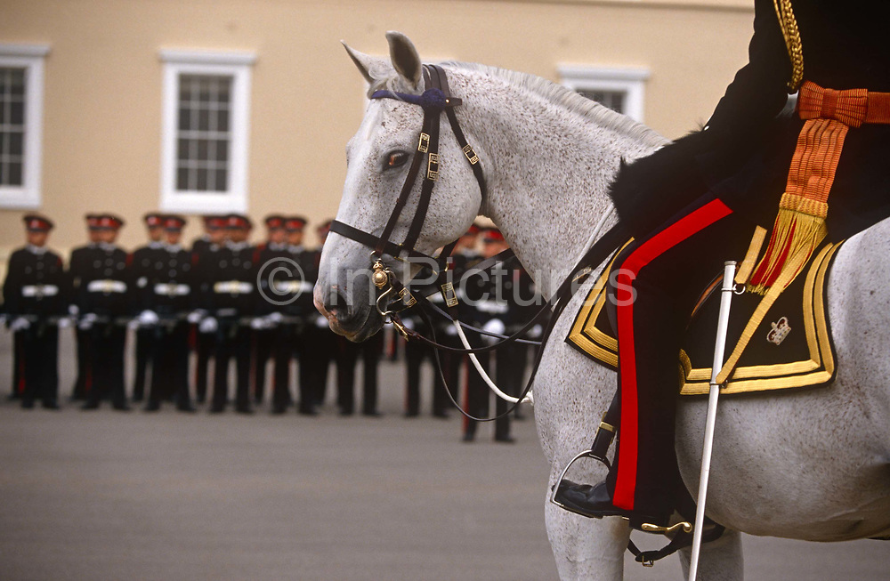 The Sovereigns passing-out parade at the Sandhurst Royal Military Academy, on 16th June 1996, at Sandhurst, England. The Royal Military Academy Sandhurst RMAS, commonly known simply as Sandhurst, is the British Army officer initial training centre. Sandhurst is prestigious and has had many famous alumni including Sir Winston Churchill, King Abdullah II of Jordan, Sultan Qaboos of Oman and, more recently, Prince Harry and Prince William. All British Army officers, and many from elsewhere in the world, are trained at Sandhurst. RMA Sandhurst was formed in 1947, from a merger of the Royal Military Academy in Woolwich which trained officers for the Royal Artillery and Royal Engineers from 1741 to 1939 and the Royal Military College at Sandhurst.