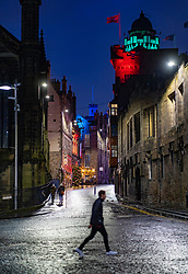 Edinburgh, Scotland, UK. 31 December 2020. Scenes of empty streets at night on Hogmanay in Edinburgh City Centre.Pre Covid-19 pandemic , the city was famous for its street entertainment on New Year's Eve and attracted many thousands of tourists every year to enjoy the New Year celebrations. Pic; The Royal Mile near is almost deserted of people. Iain Masterton/Alamy Live News