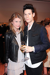 TOM TRAVIS and SABINA SZYMURA at a party to celebrate the B.zero 1 design by Anish Kapoor held at Bulgari, 168 New Bond Street, London n 2nd June 2010.