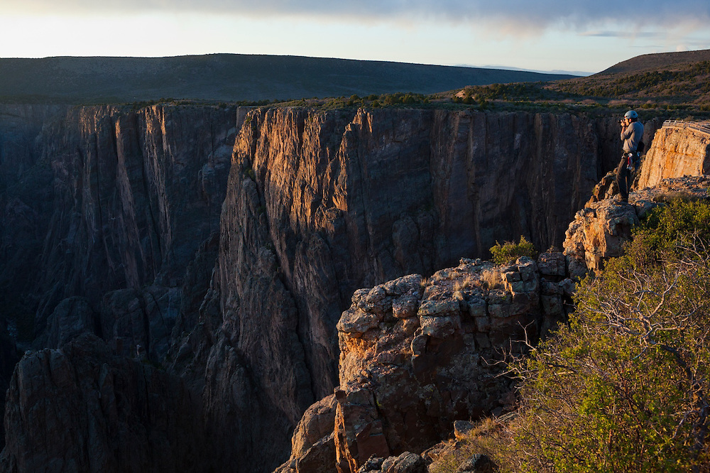 Obadiah Reid takes pictures from Island Peak at sunset in Black Canyon of the Gunnison National Park, Colorado.