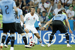 (L-R) Jose Gimenez of Uruguay, Diego Godin of Uruguay, Cristiano Ronaldo of Portugal, Martin Caceres of Uruguay during the 2018 FIFA World Cup Russia round of 16 match between Uruguay and at the Fisht Stadium on June 30, 2018 in Sochi, Russia