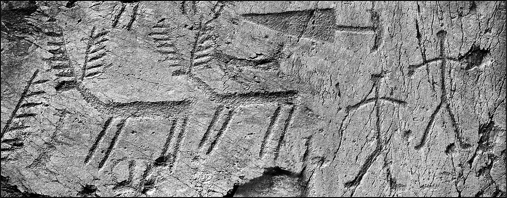 Sacred Stone - Black and white photo art print of prehistoric Rock Petroglyphs at Massi dei Cemmo  by Paul Williams. Prehistoric Rock Petroglyphs at Massi dei Cemmo Archaeological Site, Capo di Ponti, Lombardy Italy .<br /> <br /> Visit our LANDSCAPE PHOTO ART PRINT COLLECTIONS for more wall art photos to browse https://funkystock.photoshelter.com/gallery-collection/Places-Landscape-Photo-art-Prints-by-Photographer-Paul-Williams/C00001WetsxVxNTo