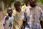 Children walk home from school at the Essaout primary school in the village of Essaout, Senegal, on Thursday June 14, 2007...