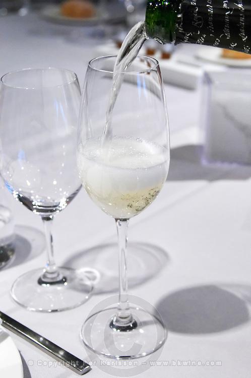 Pouring cava in a flute. Restaurant Cal Blay, Sant Sadurni d'Anoia, Catalonia, Spain.