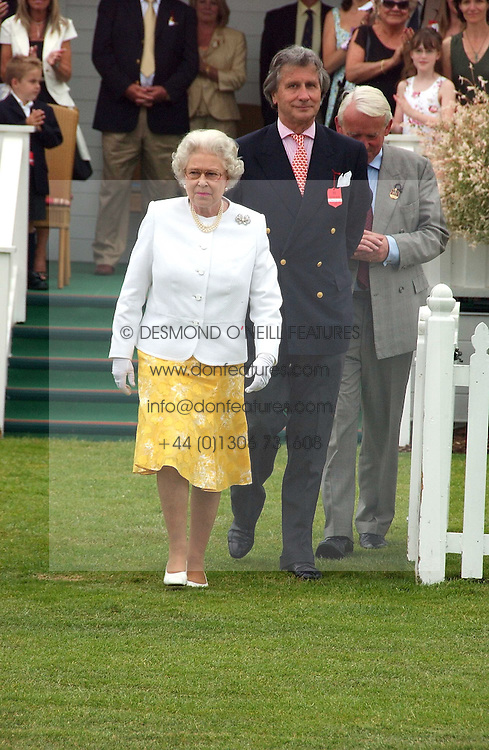 HM THE QUEEN ELIZABETH 11 and ARNAUD BAMBERGER at the Queen's Cup polo final sponsored by Cartier at Guards Polo Club, Smith's Lawn, Windsor Great Park on 18th June 2006.  The Final was between Dubai and the Broncos polo teams with Dubai winning.<br /><br />NON EXCLUSIVE - WORLD RIGHTS