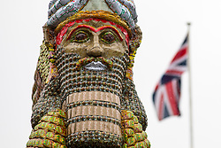 © Licensed to London News Pictures. 28/03/2018. London, UK. 'The Invisible Enemy Should Not Exist' is unveiled on Trafalgar Square's Fourth Plinth. The artwork, by Michael Rakowitz was unveiled by Mayor of London Sadiq Khan. It is made from 10,500 empty date syrup cans, representative of a once-renowned industry decimated by the Iraq Wars. The work is a recreation of the Lamassu, a winged bull and protective deity that stood at the entrance to Nergal Gate of Ninevah from c700 BC until it was destroyed by ISIS in 2015. Photo credit : Tom Nicholson/LNP