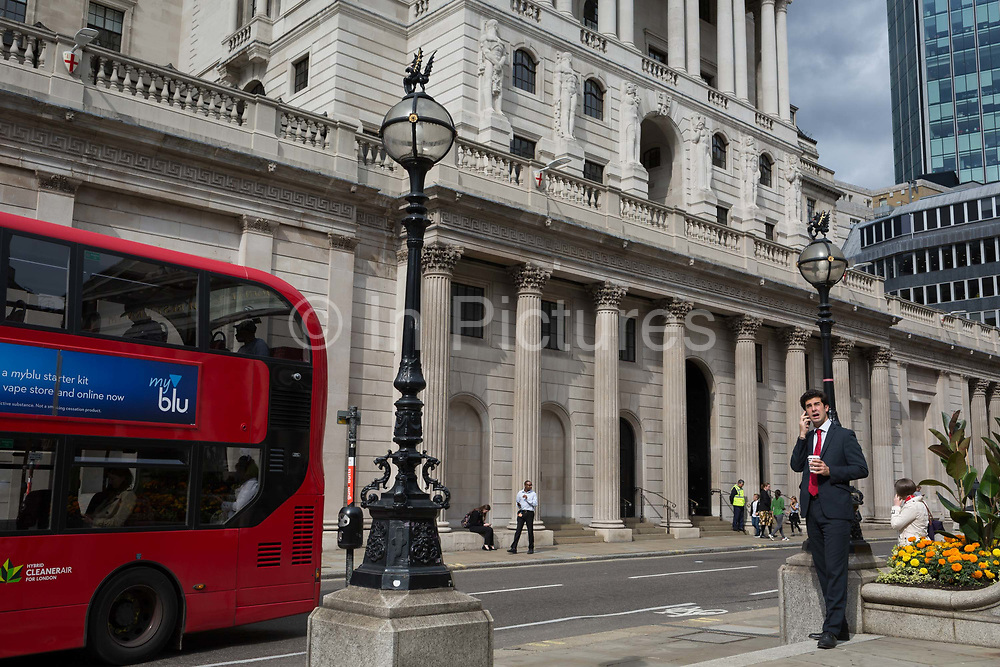 Traffic and Londoners outside the Bank of England in the City of London, the capitals financial district aka The Square Mile, on 29th August 2018, in London, England.