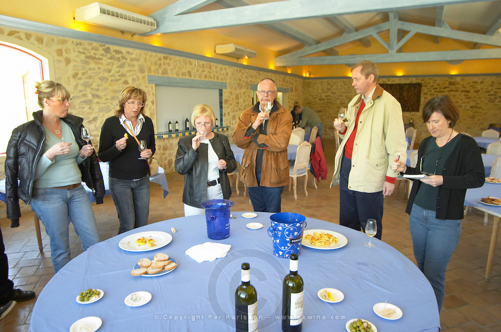 Visitors tasting wine in the tasting room, with appetizers and aperitif wines for the tasting and lunch Chateau Vannieres (Vannières) La Cadiere (Cadière) d'Azur Bandol Var Cote d'Azur France