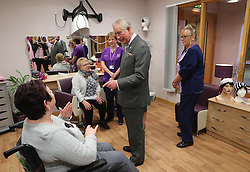 Prince Charles (known as The Duke of Rothesay when in Scotland) chats with patient Elaine Anderson (left) during his visit to the Ayrshire Hospice in Ayr where he met patients and their families, staff and volunteers, with standing-volunteer occupational therapist George Bell (left) and patient Jim Fitzsimmons (centre right) and occupational therapist Joan Carrigan (right).