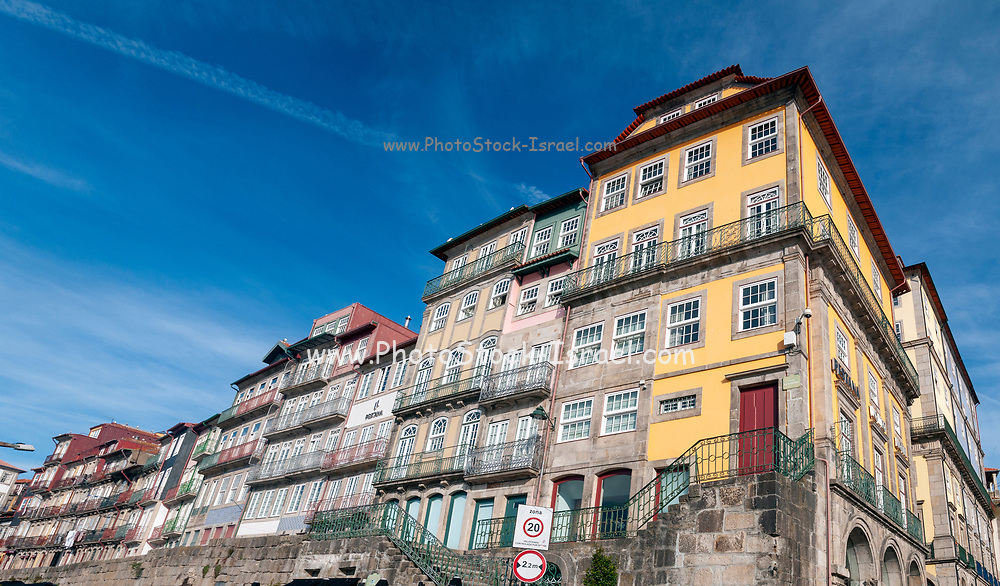 Old colorful houses of Ribeira Square, located along the Douro river in the historical center of Porto, Portugal