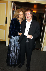 BILL WYMAN and his wife SUZANNE at the Dyslexia Awards Dinner attended by HRH The Countess of Wessex held at The Dorchester Hotel, Park Lane, London on 9th November 2005.<br />