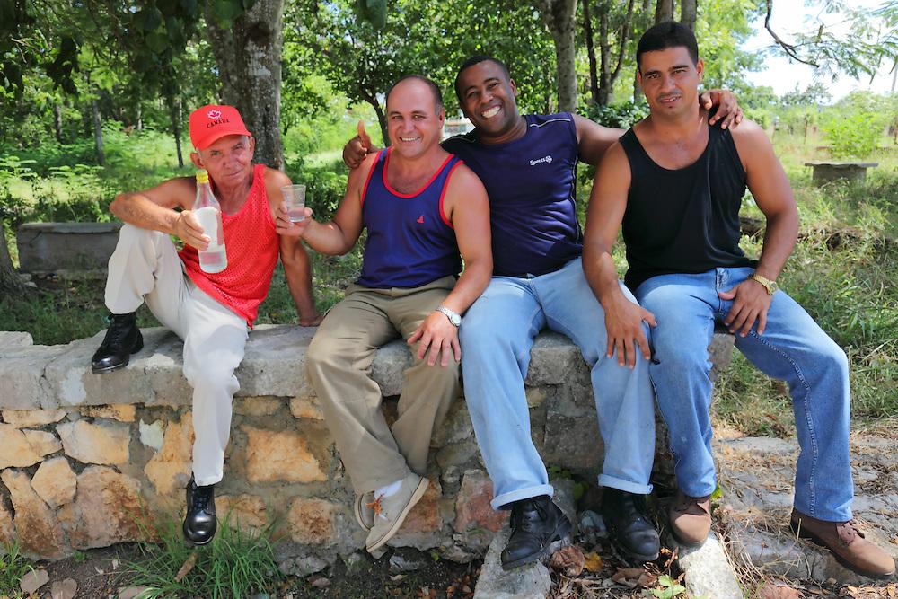 Men drinking rum in San Miguel de los Banos, Matanzas, Cuba.
