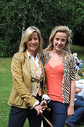 MICHELLE CADBURY and her daughter JEMIMA CADBURY and their dog Bert at the Macmillan Dog Day in aid of Macmillan Cancer Support held at the Royal Hospital Chelsea, London on 8th July 2008.<br />