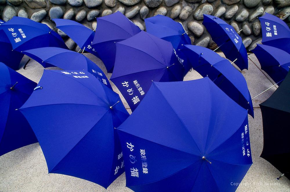 Umbrellas from Hotel Kamefuku dry on sidewalk, Miyajima, Hiroshima Prefecture, Japan