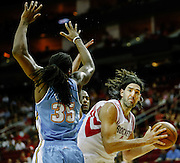 April 16, 2012; Houston, TX, USA; Houston Rockets power forward Luis Scola (4) posts up against Denver Nuggets forward Kenneth Faried (35)  during the second quarter at the Toyota Center. The Nuggets won 105-102. Mandatory Credit: Thomas Campbell-US PRESSWIRE