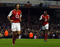 Robert Pires celebrates his opener with Patrick Vieira looks to join him