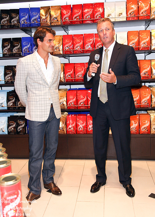 NEW YORK, NY - AUGUST 23:  (L-R) Roger Federer and Thomas Linemayr, Lindt USA CEO & President attend the Lindt Premium Chocolate party at Lindt Chocolate Shop on August 23, 2012 in New York City.  (Photo by Paul Zimmerman/WireImage)
