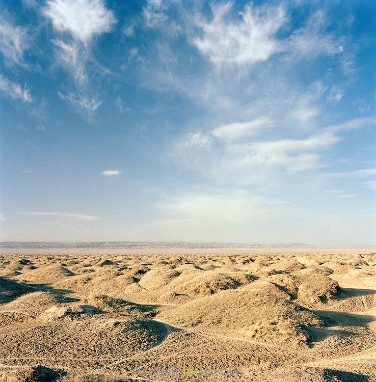 A rocky, desert landscape along the Dunhuang to Jiayuguan road, Gansu province, China