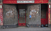American Clothing Store, derelict boarded up shop, Ipswich, Suffolk, England