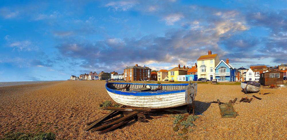 Sea front houses and fushing baist on the shingle beach of Aldeburgh , Suffolk, England .<br /> <br /> Visit our ENGLAND PHOTO COLLECTIONS for more photos to download or buy as wall art prints https://funkystock.photoshelter.com/gallery-collection/Pictures-Images-of-England-Photos-of-English-Historic-Landmark-Sites/C0000SnAAiGINuEQ
