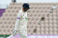 \Wicket - James Vince of Hampshire looks dejected as he walks back to the pavilion after being dismissed by Ravi Bopara of Essex lbw during the first day of the Specsavers County Champ Div 1 match between Hampshire County Cricket Club and Essex County Cricket Club at the Ageas Bowl, Southampton, United Kingdom on 5 April 2019.