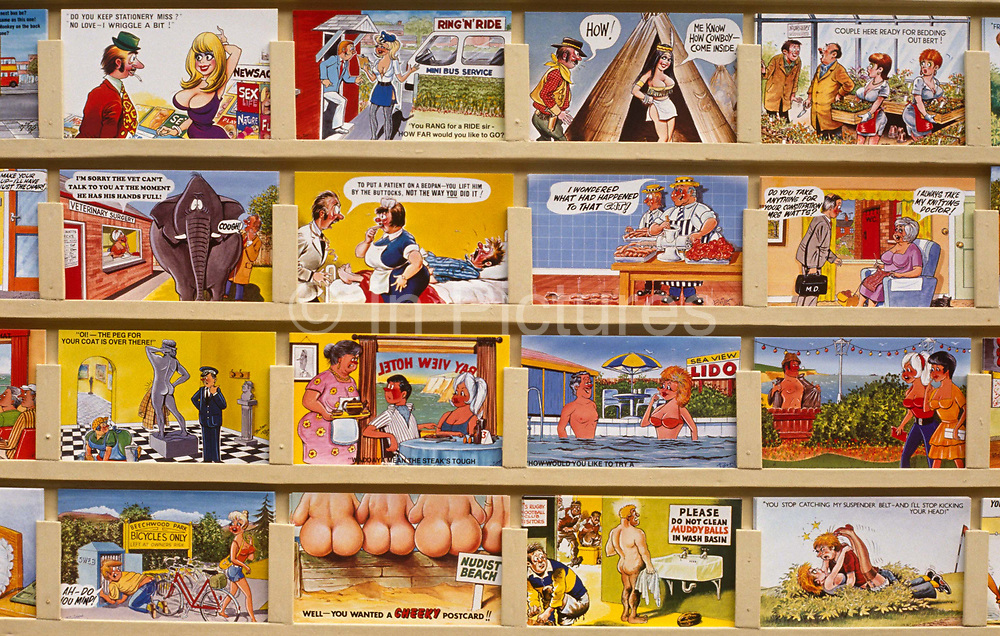 A rack of quintessentially English 'saucy postcards' are on display in Scarborough, the northern seaside town. Telling jokes to send back to friends and family, they using cartoon characters of buxom women, hen-pecked husbands or sexually-frustrated young men, the humour is bawdy and cheeky - the epitome of seaside holiday kitsch. The best-known saucy seaside postcards were created by Bamforths (founded 1870) and despite the decline in popularity of postcards that are overtly tacky, postcards continue to be a significant economic and cultural aspect of British seaside tourism. In the 1950s, Bamforth postcards were among the most popular of the 18 million items purchased at British resorts.