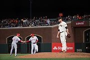 San Francisco Giants relief pitcher Hunter Strickland (60) reacts to Cincinnati Reds shortstop Zack Cozart (2) getting to second base at AT&T Park in San Francisco, California, on May 11, 2017. (Stan Olszewski/Special to S.F. Examiner)