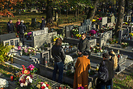 Families remember their deceased loved ones at the Rakowicki Cemetery in Krakow, Poland 2019.