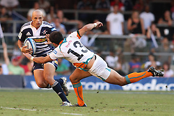 CAPE TOWN, SOUTH AFRICA - 5 MARCH 2011, Conrad Jantjes of the Stormers attempts to get past a stretching Robert Ebersohn of the Cheetahs during the Super Rugby match between DHL Stormers and Cheetahs at DHL Newlands Stadium in Cape Town, South Africa..Photo by Shaun Roy / Sportzpics