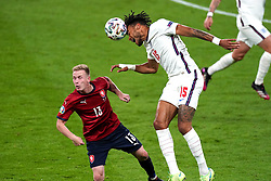 England's Tyrone Mings (right) and Czech Republic's Petr Sevcik battle for the ball during the UEFA Euro 2020 Group D match at Wembley Stadium, London. Picture date: Tuesday June 22, 2021.