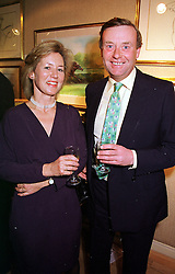 MR & MRS NICKY HENDERSON, he is the racehorse trainer at an exhibition in London on 9th March 2000.OCA 13