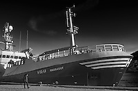 Haugagut H-50-AV fishing trawler docked in Tromsø, Norway. Image taken with a Leica X2 camera (ISO 100, 24 mm, f/5.6, 1/250 sec). Raw image processed with Capture One Pro (including conversion to B&W).