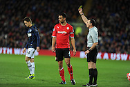 Cardiff city's Steven Caulker fouls Man Utd's Adnan Januzaj and is booked for challenge.  Barclays Premier League match, Cardiff city v Manchester Utd at the Cardiff city stadium in Cardiff, South Wales on Sunday 24th Nov 2013. pic by Andrew Orchard, Andrew Orchard sports photography,