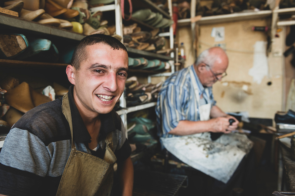 Valeri Danielyan and Mikael (Mikhail) Nersesyan work on shoes at a small workshop in Stepanakert, the capital of Nagorno-Karabakh. Mikael said he has worked with shoes for more than 50 years.<br /> <br /> (September 22, 2016)