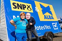 Edinburgh, Scotland, UK. 24 April 2021. Campaigners for the SNP party wear masks of Nicola Sturgeon and Alex Salmond when posing beside SNP ad van Wester Hailes in Edinburgh today. Iain Masterton/Alamy Live News